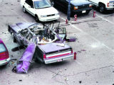 one of four photos of Gary Triano's car following the explosion that took his life in 1996....