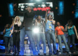 JPM703  Taylor Hicks, center, leads other American Idols Live performers, including Colorado's Ace...