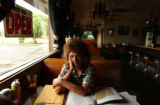 (PUEBLO, CO. JUNE 28, 2004) Donna Riebschlager, of Pueblo, sits at her family's diner The Ranchman...