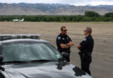 MJM1726 Boulder Police officers, Owen McKinney (cq), left, and Brandon Murray (cq), right, block...