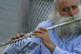 Philip Belpasso (cq) plays his flute and hands out 9/11 flyer at ground zero in Manhattan, New...