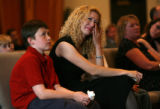 MJM050  Dustin Vollert's widow, Celeste Vollert (cq),center, cries during a memorial service for...
