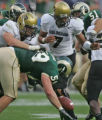 Colorado State Rams' defensive end Jesse Nading, bottom, gets hit in the back by CU's Tyler...