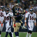 JPM218 St. Louis Rams cornerback Fakhir Brown, #34, is hoisted by Rams safety Oshiomogho Atogwe,...