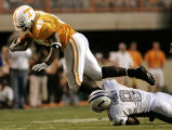 TNMH102 - Tennessee fullback Cory Anderson (45) is tripped-up by Air Force defender John Rabold...