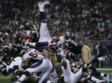 JPM023 Denver Broncos runningback Mike Bell leaps over the goal line in the closing moments of the...