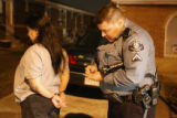 Adams County Sheriff's Deputy Leroy Olivas places Wetahanna Martinez, cq, in to custody after he...