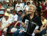 Director of the Denver-based Sea of Accordion band, Alice Aman(cq), of Thorton plays the accordion...