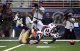The Denver Broncos' Darrent Williams (#27, CB) breaks up a pass intended for the St. Louis Rams'...