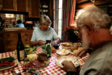 Rita Derjue(cq), left and her husband Carle Zimmerman fix lunch at their home on Indian Flats near...