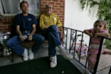Gary Heit (cq), 49, left, sits with his father Chester Pilcher Sr., (CQ), 69, middle, and grand...