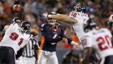 RMN035 Denver Broncos quarterback Jay Culter, #6, threads the ball past Houston Texans defensive...