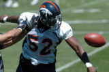 (DENVER, COLO., MAY 7, 2004)   Denver Broncos #52, D.J. Williams, right, breaks up a pass intended...