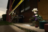 [Denver, CO - Shot on: 7/14/04] Claudia Rico, 13, placed flowers and a candle at the front door of...
