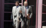 (L-R) Seth Temin ( younger, light suit) and Steve Jacobson (gray suit, older) walk out of the...
