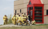 Inmates watch all of the goings o outside the Boulder County Jail Monday afternoon August 28,...