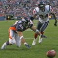 Denver Bronco's rookie tight end Tony Scheffler, left, dives for a pass thrown out of his reach in...