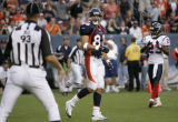 Denver Broncos Tony Scheffler, TE, center, looks back at the referee with Houston Texans #23 Dunta...