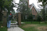Freelance cameraman Dave Westin (cq), films the front of the home in Boulder on August 28th, 2006,...