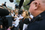 Colorado Judicial Branch spokeswoman Karen Salaz (center) speaks to the media after handing out a...