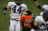 DLM03457   Douglas County High School senior linebacker Luke Diehl celebrates a turnover on downs...