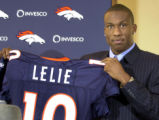 NY116 - ** FILE ** In a file photo the Denver Broncos top draft pick, Ashley Lelie, shows off his...