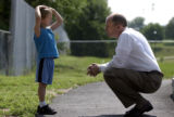 (SHERIDAN, Colo., JUNE 30, 2004)  Superintendent Mike Poore's chats with Kodie Evans at  the Early...
