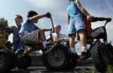 (SHERIDAN, Colo., JUNE 30, 2004)  Superintendent Mike Poore's chats with children at  the Early...