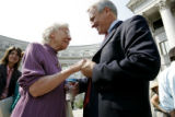 Sister Elizabeth Bornhoft O.S.F. (cq) is greeted by Bill Ritter after a rally Wednesday, September...