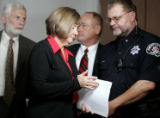 Boulder District Attorney Mary Lacy leaves after a press conference to a select group of media...