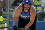 Brittany Chacon, #13 of Broomfield high school, watches the ball she just bunted during Class 4A...