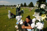 (WHEAT RIDGE, CO., JUNE 23, 2004) Brenda Diaz, of Thornton, visits the graves of son Emilio Diaz,...
