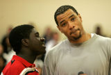 During a question and answer session Kenyon Martin, right, listens to Drew Davis, CQ, 17, left, a...