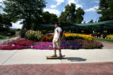 Kellen Kohl (cq) skateboards through The Annual Flower Trial Garden August 30, 2006 in Fort...