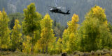 A helicopter searches  near Lower Cataract Lake in the White River National Forest Wednesday,...