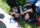 Argentine students Franco Muga (cq), 14, left, and Jorge Cot (cq), 15, right, laugh while relaxing...