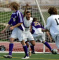 Smokey Hill senior forward Andres Osorio, middle #9 white, passes Fort Collins midfielder George...