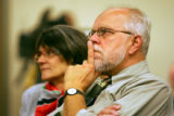Architect Eric Bartczak (cq, right) and designer Pam Bartczak (cq, left), his wife, listen on as...