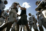 Standley Lake H.S. coach Don Morse directs his players where to in position for a play as the...
