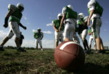 The defense huddles during scrimmage as the Standley Lake varsity football teams practice at the...
