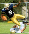 8-15-2006 Running back Andre Wilson gets tripped up by defensive back Matt Thomas during the...