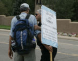 Jim Freedom (cq) of Boulder comes with a sign and his message but Deputy Sheriff Mark George...