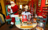 Santa Claus takes care of some last minute shopping at Cry Baby Ranch at Larimer Square where...