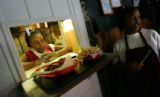 Tangy Alexander, cq, 36, left and her daughter Sherrial Alexander, cq, 15, right, work in the...