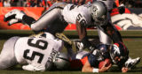 JPM1846 Oakland Raiders defensive end Derrick Burgess, #56, lands on  Denver Broncos quarterback...