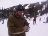 Freelance reporter Paul Willis records an entry for his Winter Park ski day in his Passport to Ski...