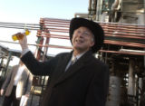 Ken Salazar holds a bottle of B100 BioDiesel fuel which is the most pure version of the options...