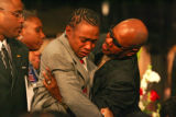 Del Land-Bankett is ovecome with emotion at the funeral for his son Joshua LyDell Land-Bankett...