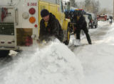 Nick Surroz (cq) and Jerry Skaggs (cq), Juniper Fire Crew - left to righr, clears snow off the...