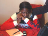 Latonya Simmons (cq) mother of Kahleed Parker, sits at the family table in her Montbello home on...